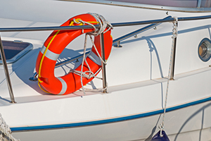 Orange life buoy on a white boat